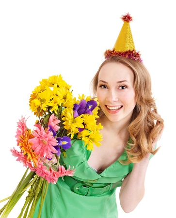 Young woman in party hat with flower. Isolated. photo