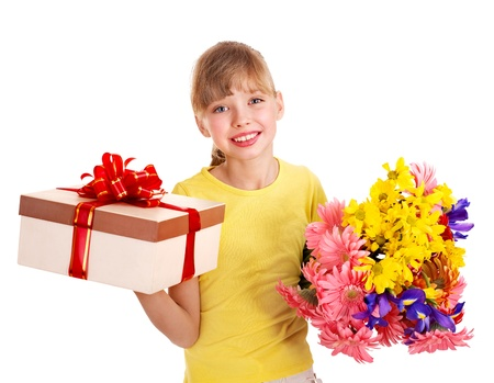 Happy little girl holding gift box and flowers. photo
