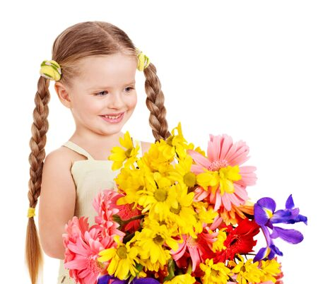 Happy little girl holding bunch of flowers. photo
