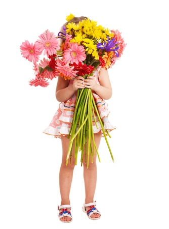 Little girl holding bunch of flowers. photo