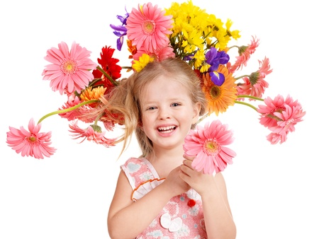 little girl smiling: Little cute girl with flower wreath. Spring hairstyle.