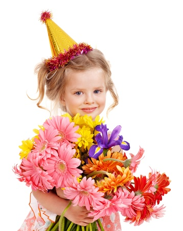 Little girl in party hat. Isolated. photo
