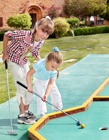 golf stick: Children playing in golf. Outdoor. Stock Photo