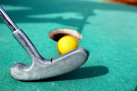 Golf stick and ball on green grass close up. Stock Photo - 9393222