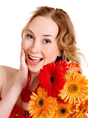 Happy young woman holding red flowers. photo