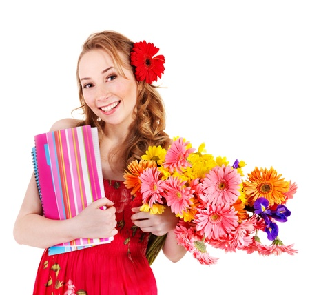Young woman holding bunch of flowers and books.. photo