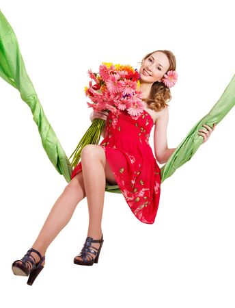 Beautiful  young woman holding  flowers on swing. photo