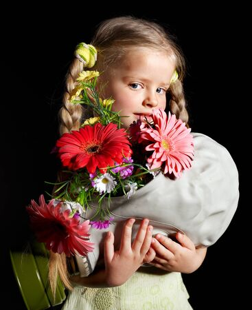 Little girl holding flowers and gas mask . Stock Photo - 9385594