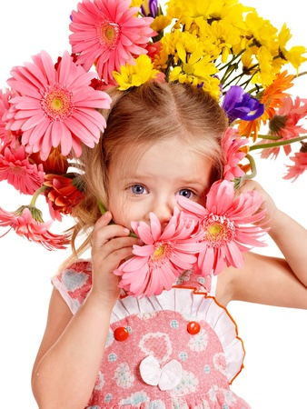 Little cute girl with flower wreath. Spring hairstyle. photo