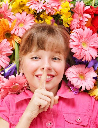 Happy little girl giving  flowers. photo