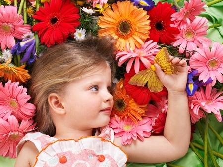 Little cute girl lying on the flower. Stock Photo - 9385743