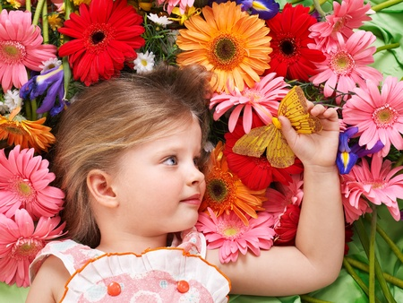 herbera: Little cute girl lying on the flower. Stock Photo