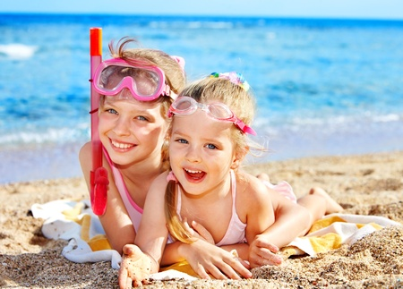 swim goggles: Children playing on  beach. Snorkeling.