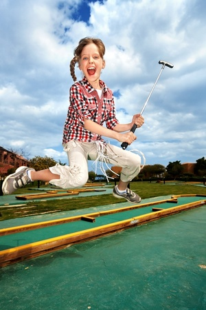 golf stick: Children playing golf in park. Outdoor.
