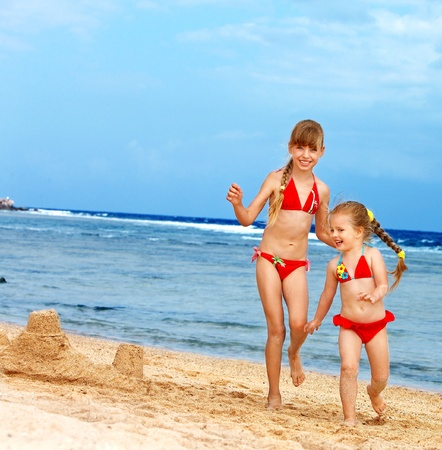 Little girl  playing on  beach. Stock Photo - 9392275