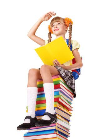 Schoolgirl sitting on pile of books. Isolated. Stock Photo - 9392305