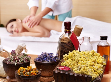 massage table: Still life with young beautiful woman on massage table in beauty spa.  Stock Photo