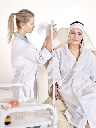 Young woman on massage chair in beauty spa. Series. photo
