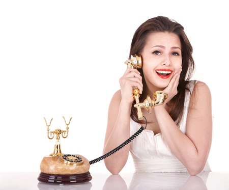 Young beautiful woman talking by phone. Isolated. photo