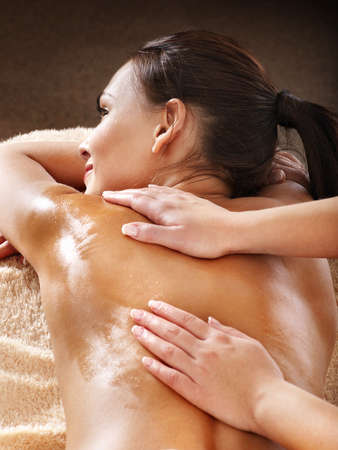 heal care: Beautiful young woman having massage. Stock Photo