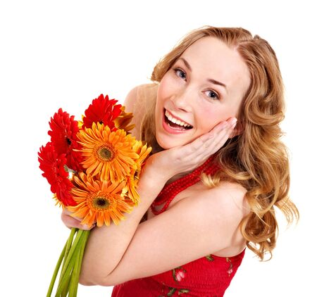 Happy young woman holding bunch of flowers. photo