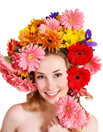toss: Young woman with flower wreath. Spring hairstyle.