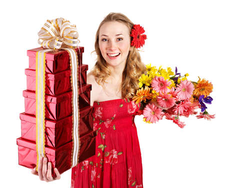 Happy young woman holding gift box and flowers. Isolated. photo
