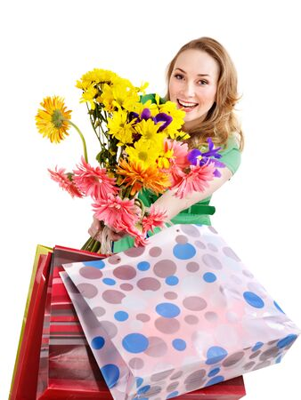 Happy young woman with shopping bag. Isolated. photo