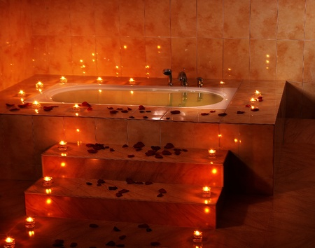 Interior of bath tub with candle.  photo