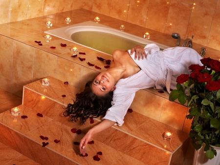 Woman sitting on edge of bath tub. Stock Photo - 9523360