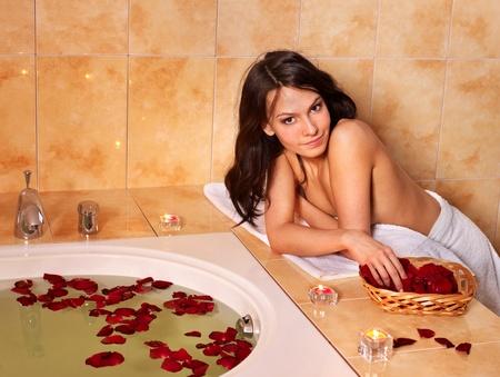 Woman sitting on edge of bath tub. Stock Photo - 9526610
