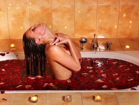 Woman relaxing in bath with rose petal. Stock Photo - 9523364