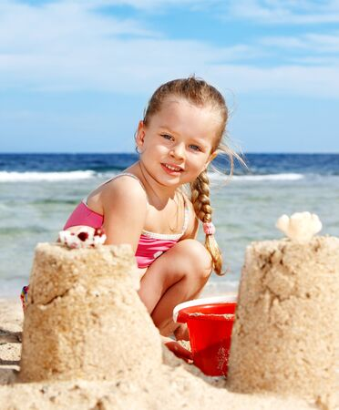 Little girl  playing on  beach. Stock Photo - 9620085