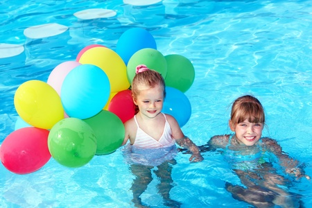 little girl playing with balloons in swimming pool. Stock Photo - 9620064