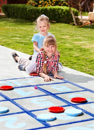 playing games: Children playing in golf. Kids outdoor games. Stock Photo