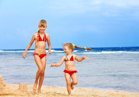 little girl beach: Little girl  playing on  beach.
