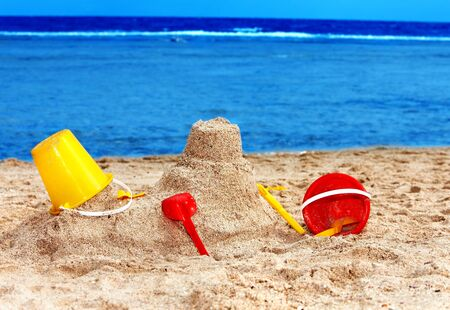 bucket and spade: Kids toys on sand beach. Concept. Stock Photo