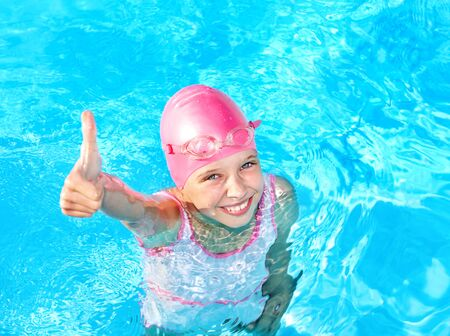 swimming goggles: Little girl  swimming in pool. Stock Photo