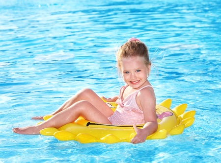 inner beauty: Child  on inflatable ring in swimming pool.
