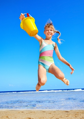 kids playing beach: Little girl  playing on  beach.