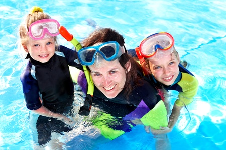 Children in swimming pool learning snorkeling. Sport. Stock Photo - 9620170