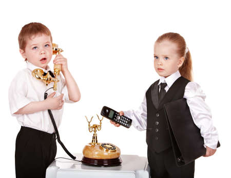 Children in business suit with telephone. Isolated. photo