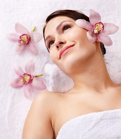 parlor: Beautiful young woman having massage. Stock Photo