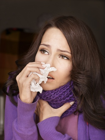 Young woman with handkerchief having  cold. Isolated. Stock Photo - 9620348