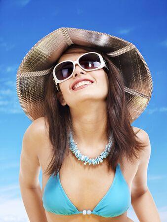 Girl in bikini and sunglasses on beach. Vacation. photo