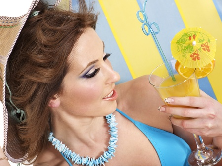 Girl in bikini drink juice through  straw. photo