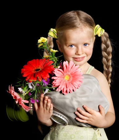 Little girl holding flowers and gas mask . Stock Photo - 9620044