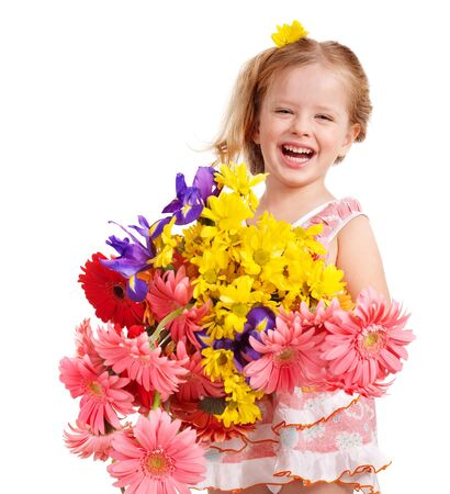 little girl smiling: Happy little girl holding bunch of flowers.