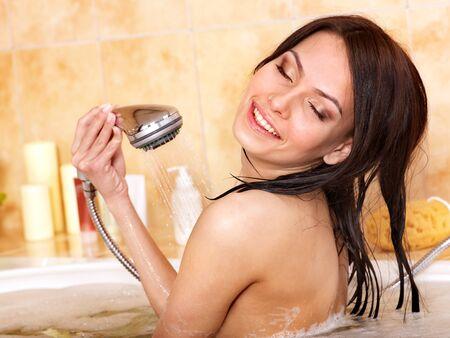 female in douche: Young woman take bubble  bath.