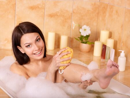 Woman relaxing in bubble bath . photo